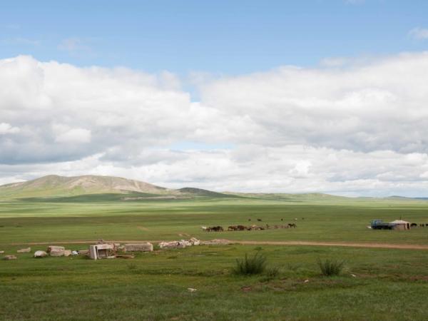 Výhled do krajiny a jednu pasteveckou rodinu.